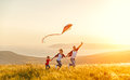 Happy family father of mother and child daughter launch a kite o Royalty Free Stock Photo