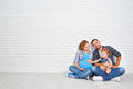 Happy family father and pregnant mother and child daughter near Royalty Free Stock Photo
