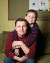 Happy family father and son at home portrait of a boy with his having fun Stock Images