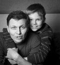 Happy family father and son at home portrait of a boy with his having fun Royalty Free Stock Image