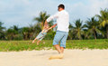 Happy family father turns baby son on beach Royalty Free Stock Photo