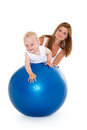 Happy family with fitness ball mother and sweet small baby on a white background healthy Stock Images