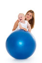 Happy family with fitness ball mother and sweet small baby on a white background healthy Royalty Free Stock Photos