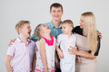 Happy family of five people children look at each other in the studio Stock Photos