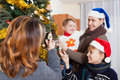 Happy family of four celebrating new year portrait Royalty Free Stock Photography