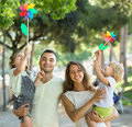 Happy family of four walking with children Royalty Free Stock Photo
