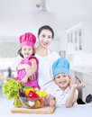 Happy family with fresh vegetable at home Stock Photos