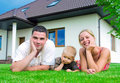 Happy family in front of the house Royalty Free Stock Photos