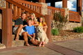 Happy family on front steps Stock Image