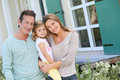Happy family in front of their new home Royalty Free Stock Photo