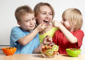 Happy family with fruit salad Royalty Free Stock Photo