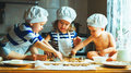 Happy family funny kids bake cookies in kitchen Royalty Free Stock Photo