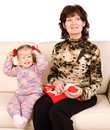 Happy family grandmother knits, child read book. Stock Images