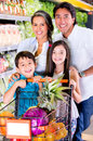 Happy family at the grocery store Royalty Free Stock Photo
