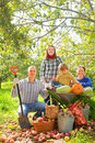 Happy family harvest vegetable garden Royalty Free Stock Photo