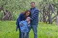 Happy family have fun in apple garden Stock Photo