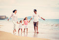 Happy family have fun walking on beach at sunset young Royalty Free Stock Photo