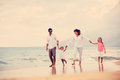Happy family have fun walking on beach at sunset young Royalty Free Stock Images