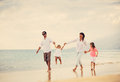 Happy Family have Fun Walking on Beach at Sunset Royalty Free Stock Photo