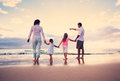 Happy family have fun walking on beach at sunset young Royalty Free Stock Photography