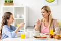 Happy family having breakfast at home kitchen Royalty Free Stock Photo