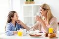 Happy family having breakfast at home kitchen Royalty Free Stock Photo