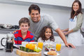 Happy family having breakfast in kitchen Royalty Free Stock Photo