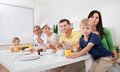 Happy family having breakfast together Royalty Free Stock Photos