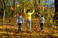 Happy family having fun in autumn forest Royalty Free Stock Photo