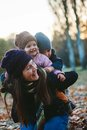 Happy family having fun on beautiful autumn day Stock Photos