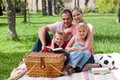 Happy family having fun in a park Stock Photography