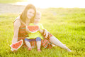 Happy family having picnic on green grass in park Royalty Free Stock Photo