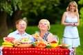 Happy family having picnic outdoors Royalty Free Stock Photo