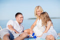 Happy family having a picnic summer holidays children and people concept Royalty Free Stock Image