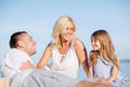 Happy family having a picnic summer holidays children and people concept Stock Photos
