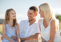 Happy family having a picnic summer holidays children and people concept Stock Image