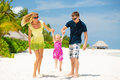 Happy family having tropical vacation fun on the white sandy beach at maldives Royalty Free Stock Photos