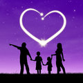 Happy family with heart silhouette of a walking in the park in the sky Royalty Free Stock Photos