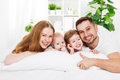 Happy family at home in  the bed Royalty Free Stock Photo