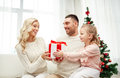 Happy family at home with christmas gift box Royalty Free Stock Photo