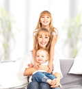 Happy family at home on couch mother and daughter and son the children Royalty Free Stock Photo