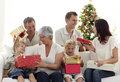 Happy family at home opening Christmas presents Royalty Free Stock Photos
