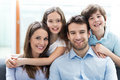 Happy family at home smiling relaxing Stock Photo