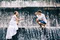 Happy family honeymoon holiday. Couple in cascade waterfall pool. Royalty Free Stock Photo