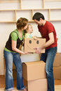 Happy family with a kid moving into a new home Royalty Free Stock Photo