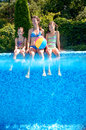 Happy family with kids having fun in swimming pool on vacation Royalty Free Stock Photo