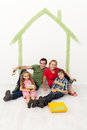 Happy family with kids redecorating their home together concept Stock Photography