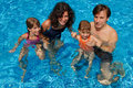 Happy family with kids in swimming pool Royalty Free Stock Images
