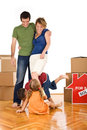 Happy family with kids in their new home Royalty Free Stock Photo