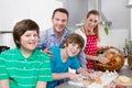 Happy family in the kitchen preparing breakfast on sunday. Royalty Free Stock Photo